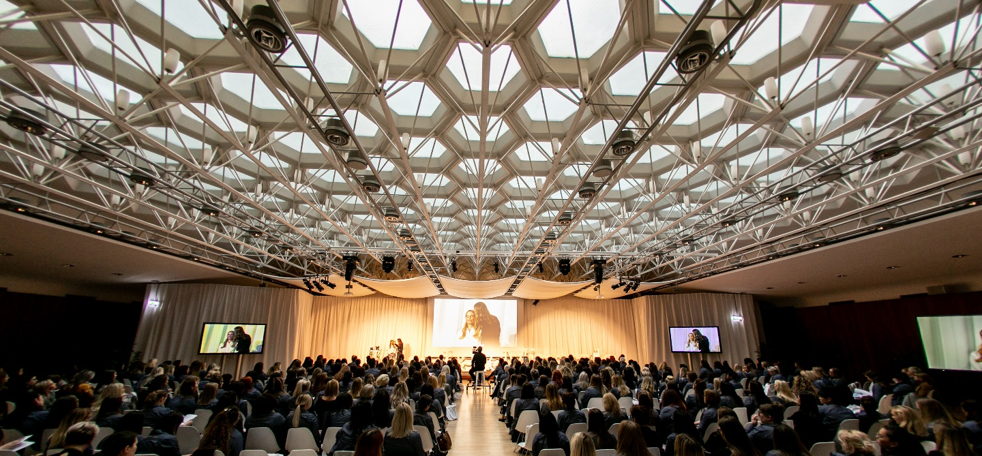 Wide shot of BareMinerals conference at Congress Centre