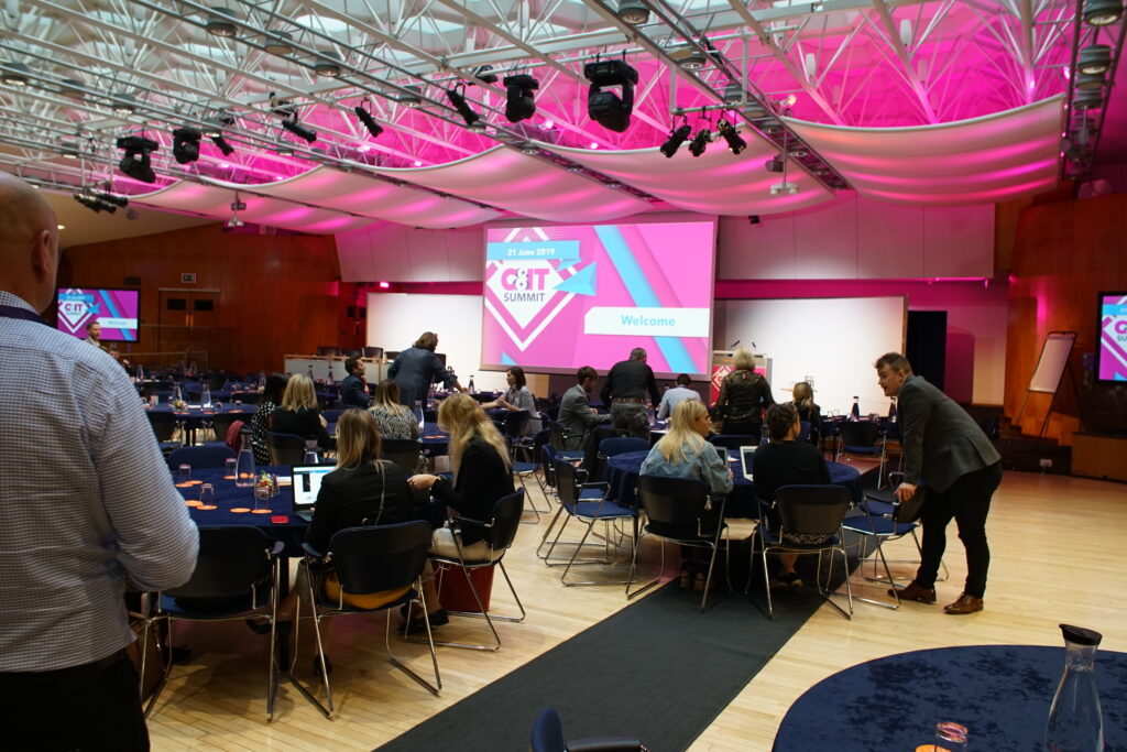 Delegates taking part in the C&IT Summit at conference venue London Congress Centre